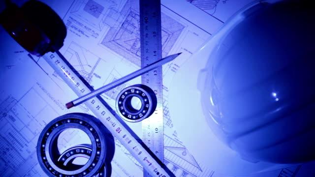 engineering equipments on the blue prints - construction workwear floor bildbanksvideor och videomaterial från bakom kulisserna