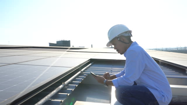 Engineering inspect a solar panel
