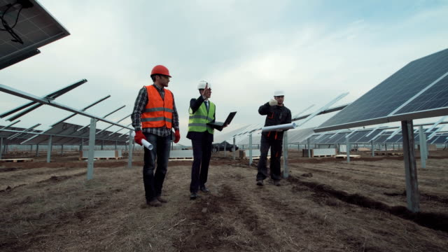 Engineers discuss building of a solar farm video