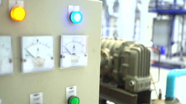 Engineers examining machinery in control room