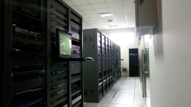 engineer's inspection equipment in tv broadcasting and control computer room - вешалка стоковые видео и кадры b-roll