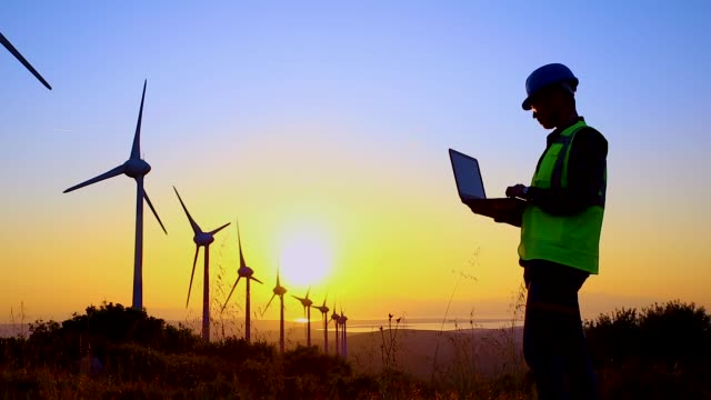 Engineers of wind turbine Engineers of wind turbine. work helmet stock videos & royalty-free footage