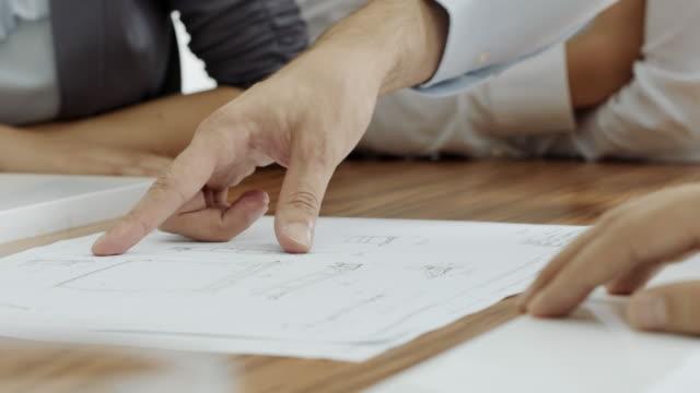 Engineers planning on blueprint