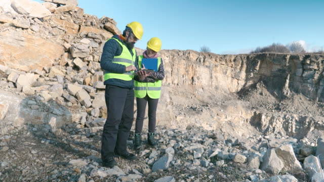engineers working on a stone quarry. - ghiaia video stock e b–roll