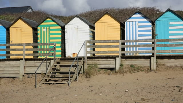 english beach huts traditional seaside pan view colourful - prom stock videos and b-roll footage