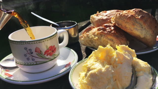 english cream tea sunny afternoon table - scone filmów i materiałów b-roll
