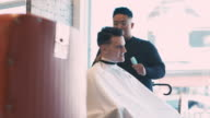 istock English style barber shop action 1159675310