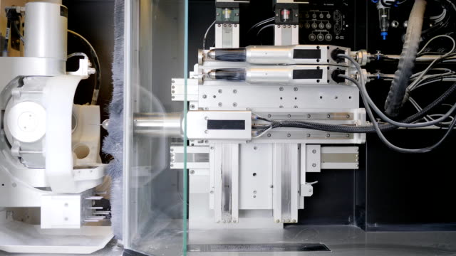 CNC engraver in action, technologies of dental implants production on milling machine in medicine video