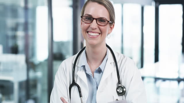I enjoy this doctor life myself 4k video footage of an attractive young female doctor smiling while standing with her arms crossed in a hospital female doctor stock videos & royalty-free footage