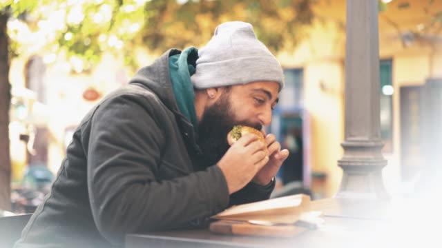 Enjoying a burger outdoors. video