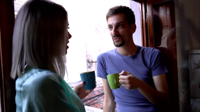 enjoying a cup of coffee with a friend - miroslav mitic stock videos and b-roll footage