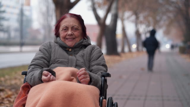Enjoying every day of life Portrait of senior woman in wheelchair real people stock videos & royalty-free footage