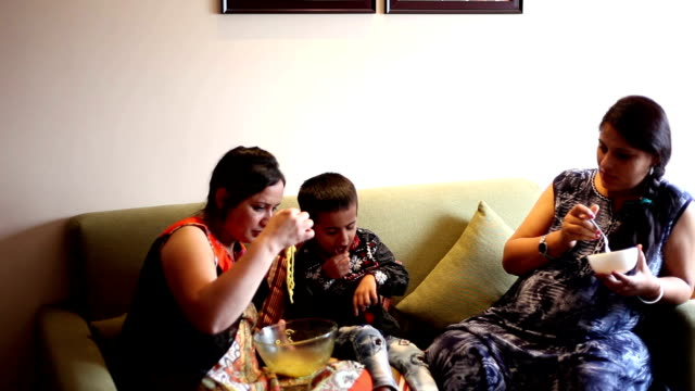 Enjoying noodles HD1080p : Family enjoying noodles at night. indian family stock videos & royalty-free footage