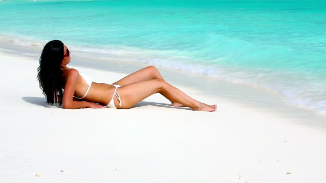 Enjoying sun at the beach video