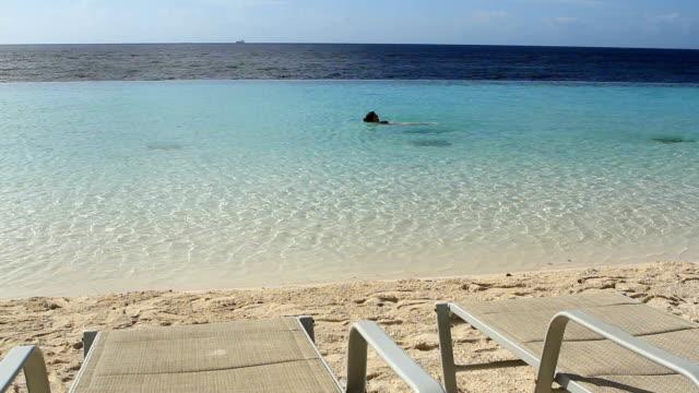 Enjoying the Beach Lady swimming in the beach enjoying vacations leeward dutch antilles stock videos & royalty-free footage