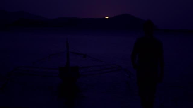 Enjoying the moonlight at the beach Enjoying the moonlight at the beach recreational boat stock videos & royalty-free footage