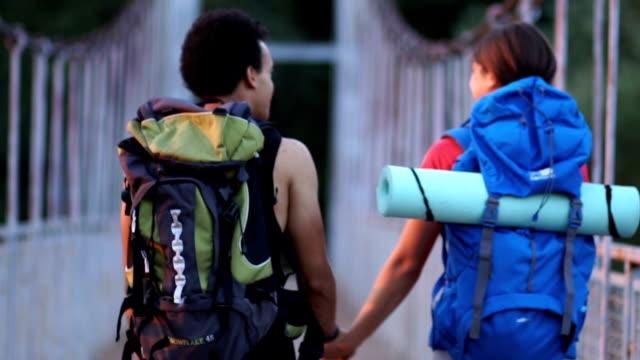 enjoying the nature and sunset - турист с рюкзаком стоковые видео и кадры b-roll