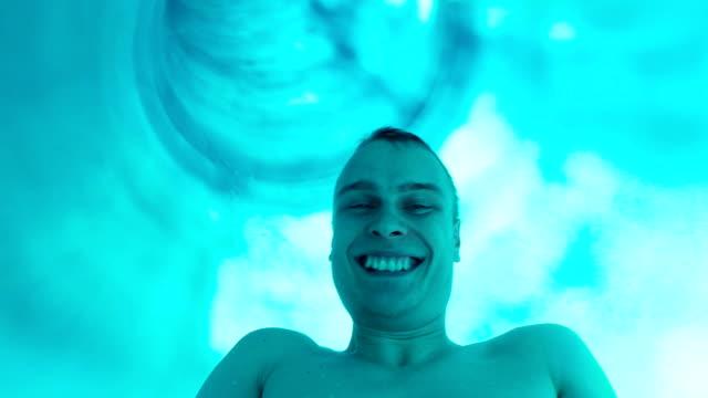 Enjoyment on the water slide Enjoyment on the water slide aquatic organism stock videos & royalty-free footage