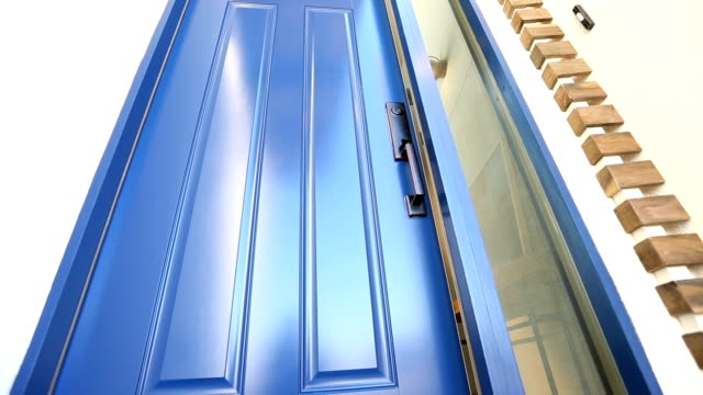 Enter Home Through Front Door Opening front door opens as the camera moves toward the entrance to reveal the modern industrial home interior facade stock videos & royalty-free footage