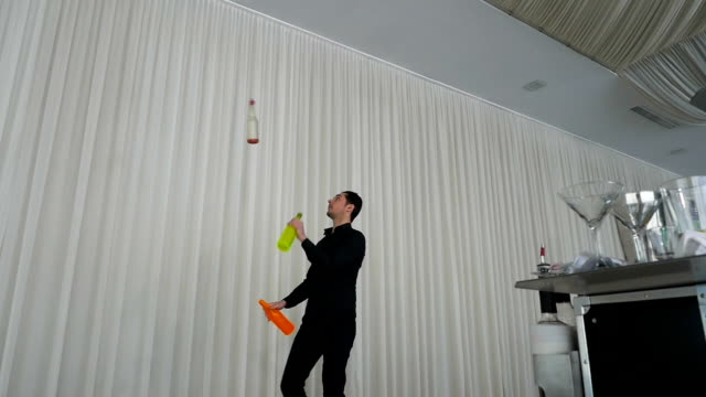 Entertainer performing show using flair bartending techniques video