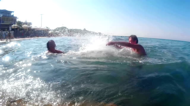 Entertainment on the Sea - Man and Woman Splashing in Water video