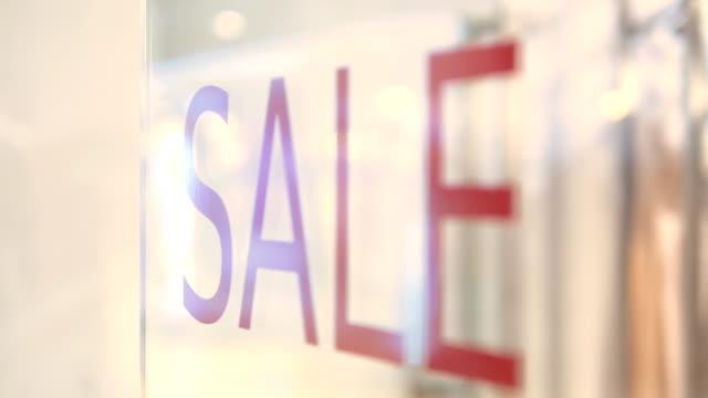 stockvideo's en b-roll-footage met ingang verkoop!!! - shop sign