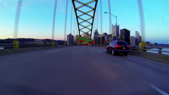 Entrance to city across the bridge Entrance to  city across the bridge fork stock videos & royalty-free footage