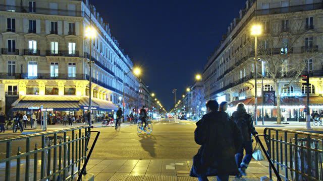 Entrance to Subway in Paris. Nighttime. Illuminated Buildings. Street Style.