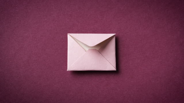 Envelope with letter, stop motion animation. Paper art.