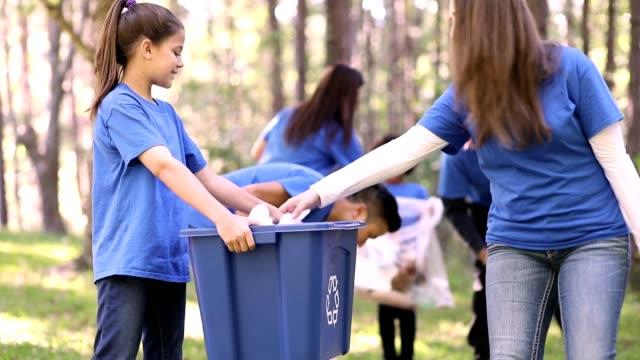 Environmental clean up. Volunteers pick up trash in local park. video