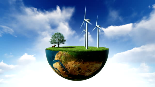 Environmental concept, Earth globe holding wind turbines against blue sky