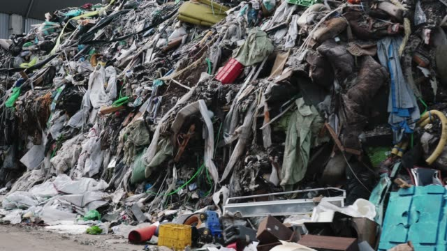 Environmental issues Close up of a huge pile of waste at waste disposal dump. Garbage lying around, is scary to think how much waste people make all around the world. dump truck stock videos & royalty-free footage