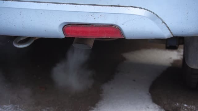 Environmental pollution of air by car exhaust pipe