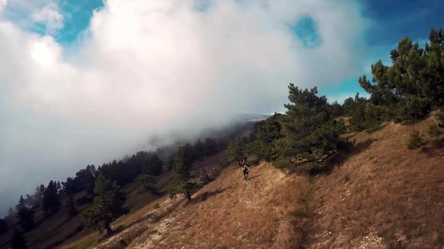 Epic aerial view of mountain. Movement of the clouds. Bike riders. Crimea. Plateau Baba-Dag. Cave city Mangup-Kale. video