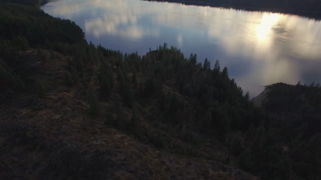 Epic Cinemtaic Aerial Reveal of Scattered Clouds Over Lake with Misty Mountai video