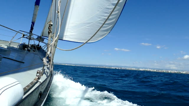 Epic - Sailing yacht on wind-filled sails (slow motion) Epic - Sailing yacht on wind-filled sails (slow motion) mast sailing stock videos & royalty-free footage