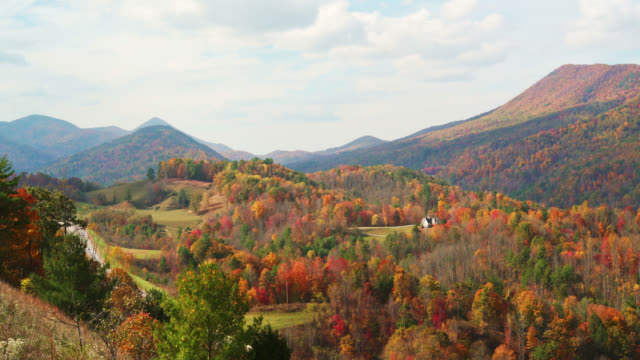 Epic scenic view to the colorful autumn mountain's forests from the Metcalf Overlook, Unicoi County, Tennessee, USA