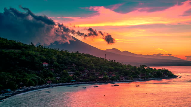 Epic sunset timelapse in the Jemeluk bay with a view of the ocean and clouds above the volcano Agung in Bali in Indonesia. FullHD Timelapse in Bali Island, indonesia high dynamic range imaging stock videos & royalty-free footage