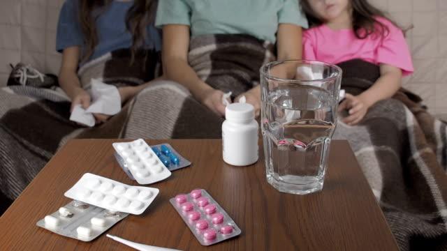 vídeos de stock e filmes b-roll de epidemic. the family has a viral infection. - pneumonia