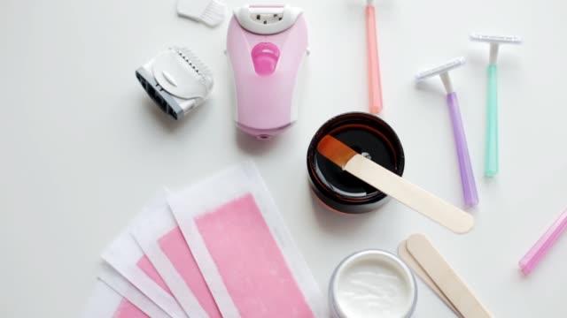 epilator with razors, depilatory wax and strips - depilacja filmów i materiałów b-roll