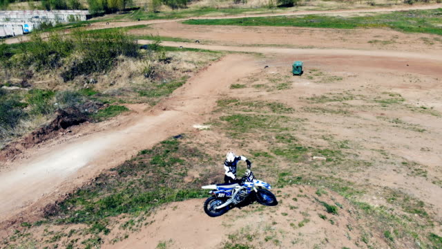 equipped and prepared motorcycler in the middle of a race track - supercross video stock e b–roll