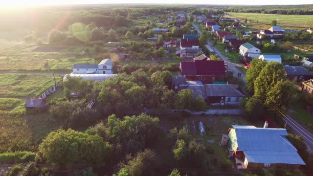 аerial utsikt över byn och husen - roof farm bildbanksvideor och videomaterial från bakom kulisserna