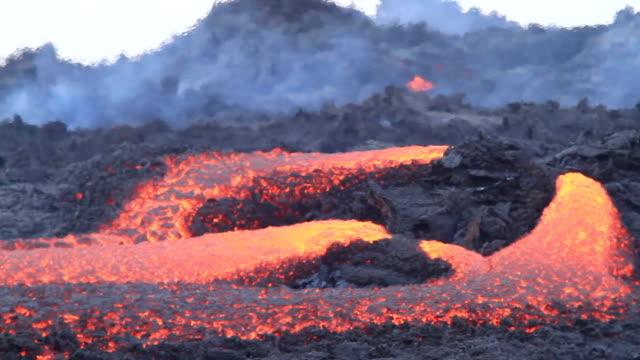 eruption of volcano lava flow - reunion stock videos & royalty-free footage