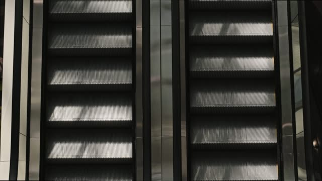 escalator in the building. - escalator video stock e b–roll