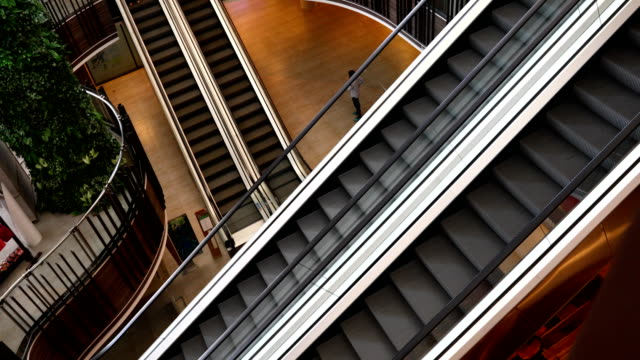 escalator moving staircase - escalator video stock e b–roll