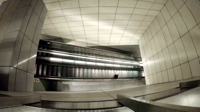 Escalator Escalator in the ground train station exchange rate stock videos & royalty-free footage