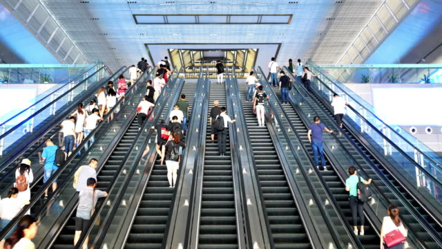 escalator with crowded people in suzhou railway station video