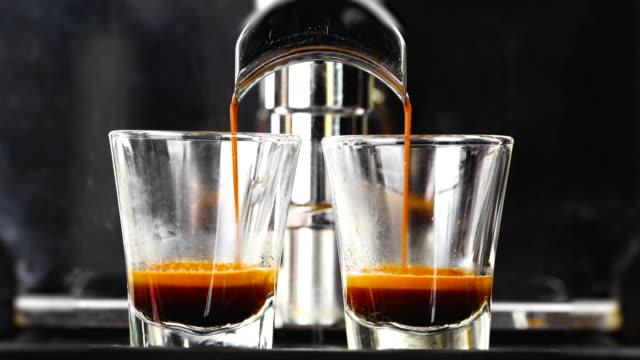espresso coffee from machine close up. - espresso filmów i materiałów b-roll