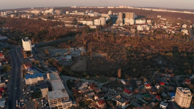 establishing aerial shot of abandoned area in chisinau, moldova at sunset - молдавия стоковые видео и кадры b-roll