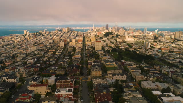 Establishing Aerial View Down Town San Francisco Low clouds sun set Establishing Aerial View Down Town San Francisco Low clouds sun set bay bridge Transamerica Pyramid oakland stock videos & royalty-free footage
